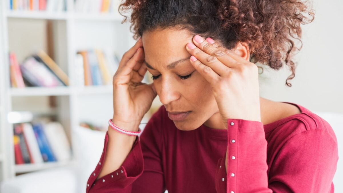 Woman holding her head - feeling stressed