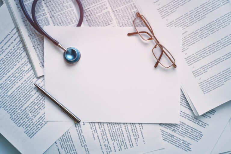 Papers stethoscope and glasses